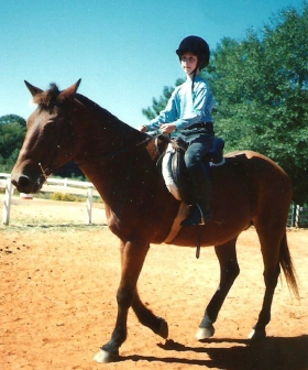 Learning to ride Doughboy, one of her favorite horses at the stable where she took therapeutic riding lessons