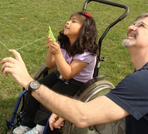 Learning to fly a kite with Daddy