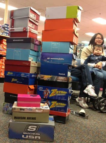 Our growing pile of new shoes at Shoe Carnival
