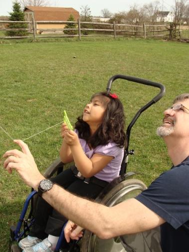Helping Kathryn fly a kite