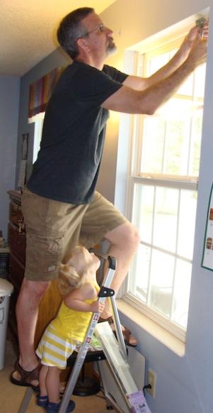 Gabriela Helping Grandad Hang Blinds
