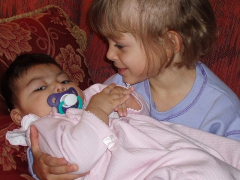 Holding a brand new sister - Carlin's capacity to love has always been so clearly seen in her care and concern toward her baby sister, Kathryn
